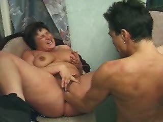 Chubby lady with big boobs in threesome in kitchen