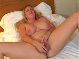 Blond sweetheart with huge melons having orgasm solo