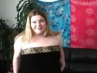 Paunchy chubby chick blows hard dick on sofa