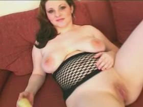 Enormous redhead lady enjoys vibrator on sofa