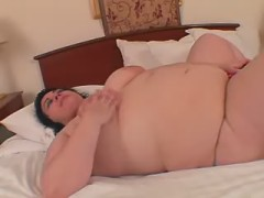 Chubby busty blonde solo with dildo on sofa